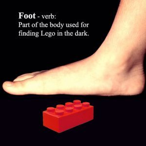 Image showing bare foot standing on lego